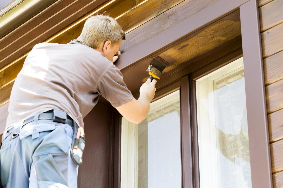 professional painter doing exterior painting