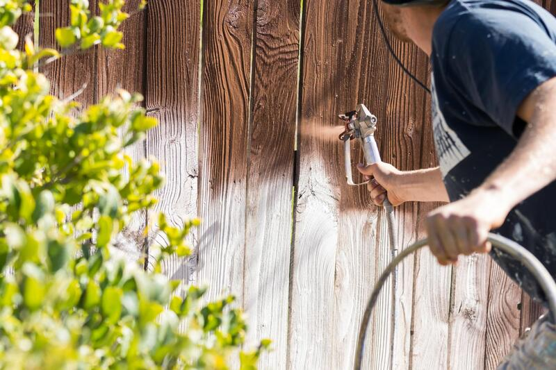 professional painter doing fence staining