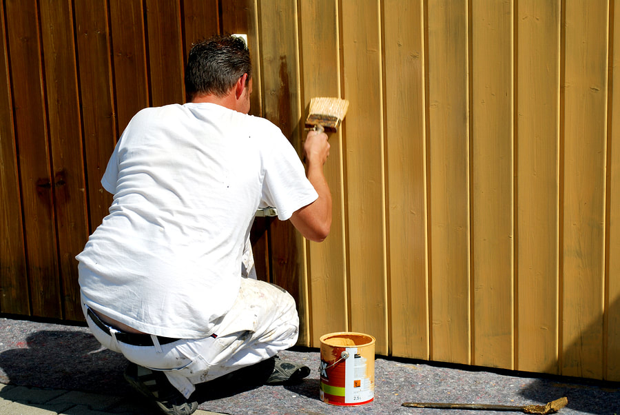 professional painter doing fence painting