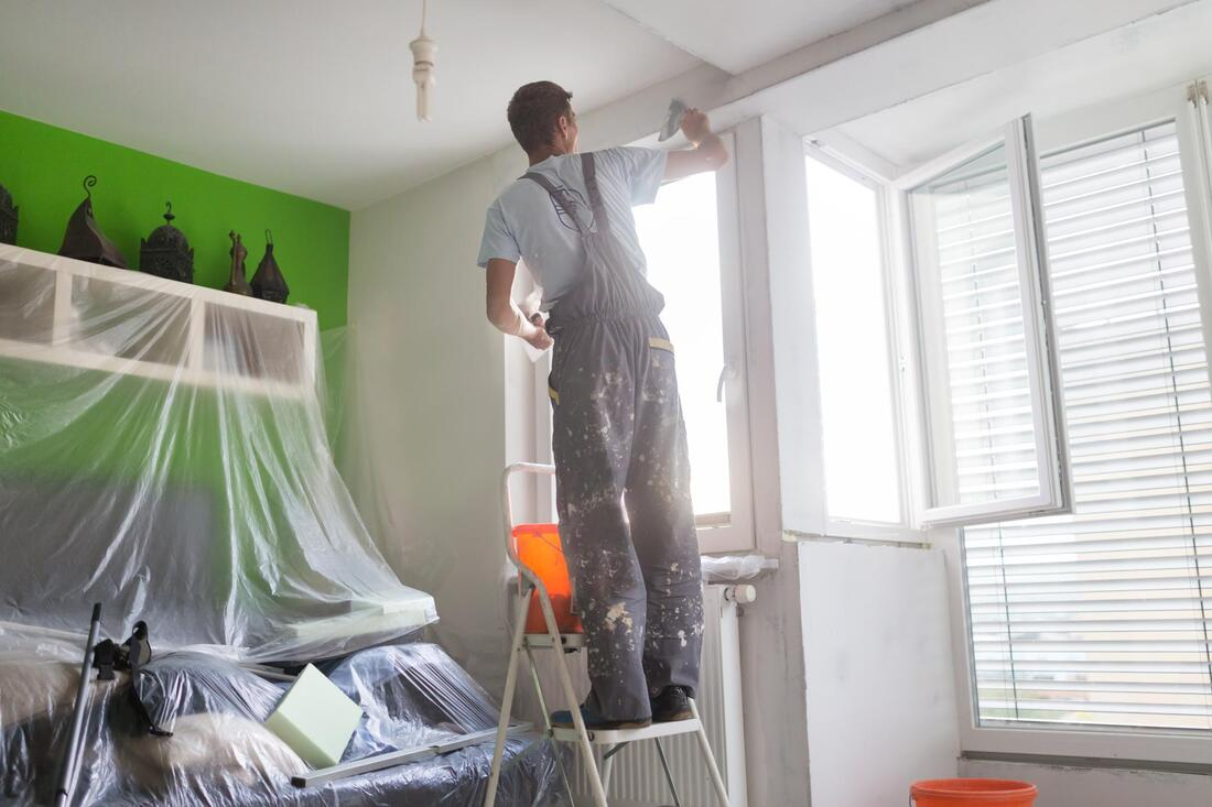 professional painter doing interior painting